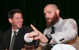 Boston Red Sox outfielder Jonny Gomes, right, talks with teammate Craig Breslow during the autograph session before the 75th annual Boston Chapter of the Baseball Writers Association of America (BBWAA) Awards Dinner at Westin Copley Place Hotel on Thursda